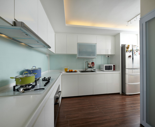 Example Of A Mid Sized Asian L Shaped Porcelain Floor Enclosed Kitchen Design In