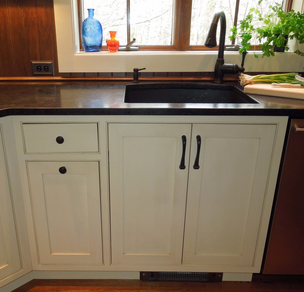 Example of a mid-sized classic l-shaped medium tone wood floor open concept kitchen design in Charleston with an undermount sink, beaded inset cabinets, white cabinets, granite countertops, brown backsplash, stainless steel appliances and an island