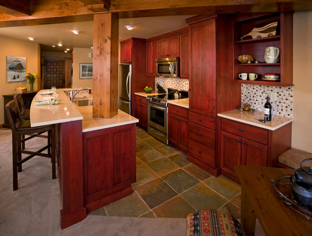 ski condo red cabinets rustic kitchen other metro