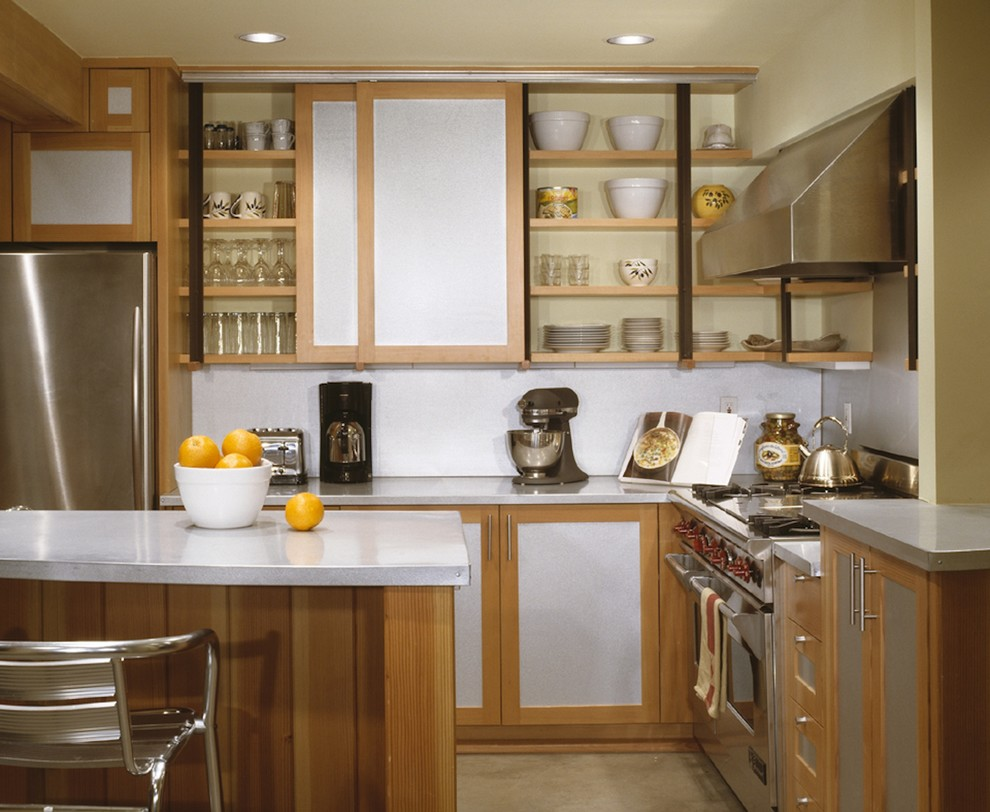 Mountain style kitchen photo in Austin with stainless steel appliances, open cabinets, white backsplash and medium tone wood cabinets