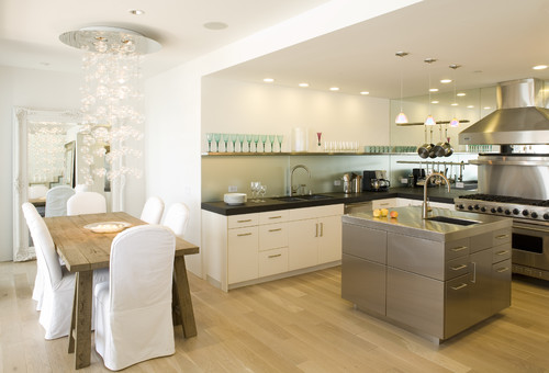 Sleek, elegant kitchen with frosted glass backsplash, staniless steel island modern kitchen
