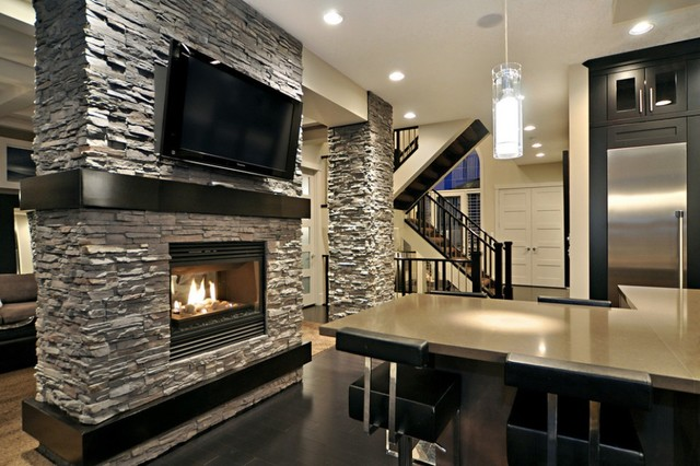 Sleek kitchen with stone accents contemporary-kitchen