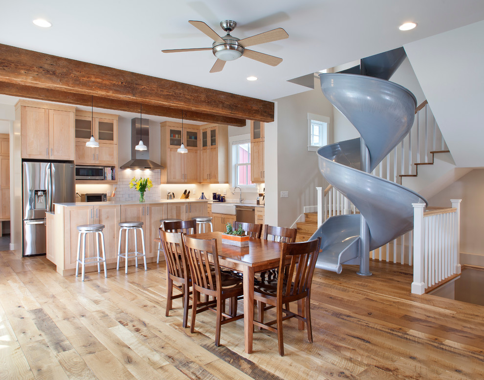 Eat-in kitchen - transitional medium tone wood floor eat-in kitchen idea in Denver with a farmhouse sink, shaker cabinets, light wood cabinets, solid surface countertops, white backsplash, subway tile backsplash, stainless steel appliances and an island