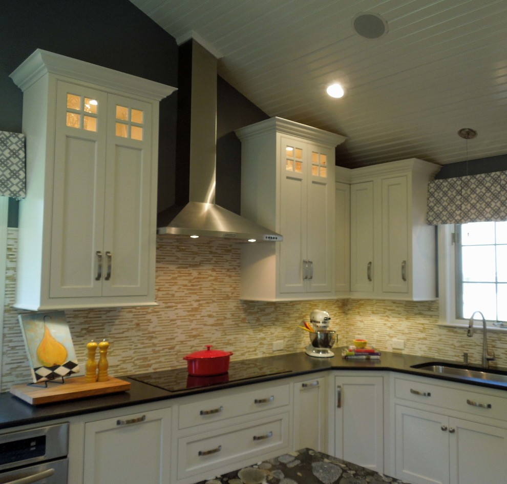Elegant u-shaped eat-in kitchen photo in Boston with an undermount sink, recessed-panel cabinets, white cabinets, granite countertops, multicolored backsplash and stainless steel appliances