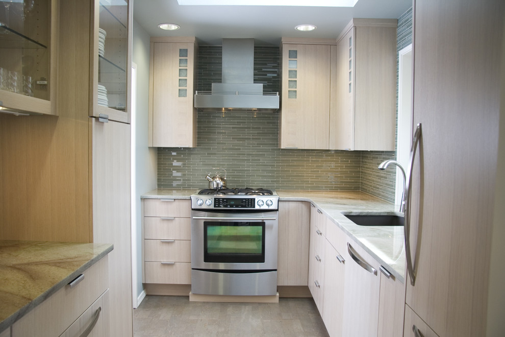 Inspiration for a contemporary u-shaped enclosed kitchen remodel in Portland with flat-panel cabinets, stainless steel appliances, granite countertops, an undermount sink, light wood cabinets, green backsplash and glass tile backsplash
