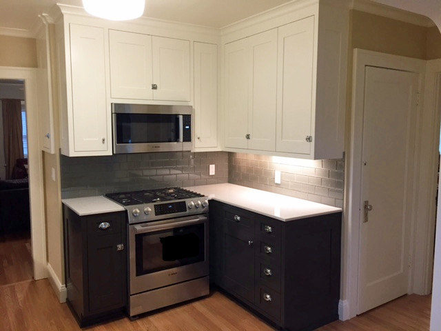Small period kitchen with inset painted grey cabinets