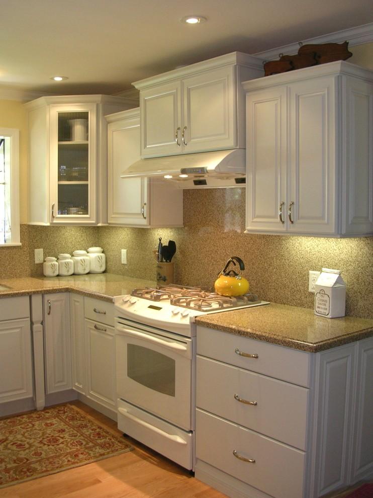 Elegant kitchen photo in San Francisco with white appliances