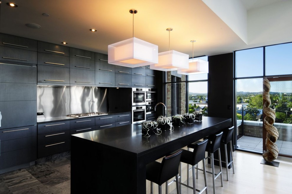 Trendy kitchen photo with black cabinets, metallic backsplash and stainless steel appliances