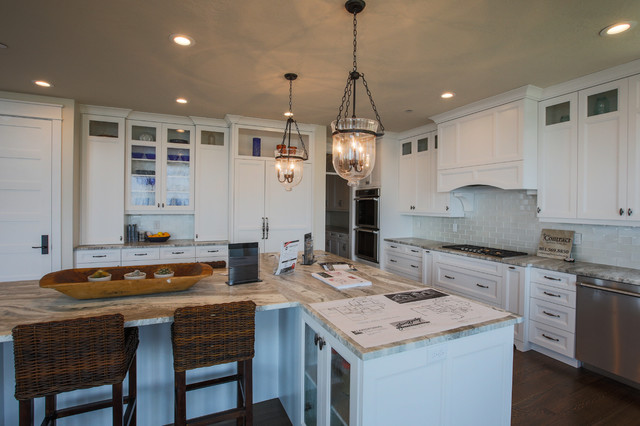 Example of a large transitional medium tone wood floor open concept kitchen design in Salt Lake City with an undermount sink, shaker cabinets, white cabinets, white backsplash, subway tile backsplash, paneled appliances and an island