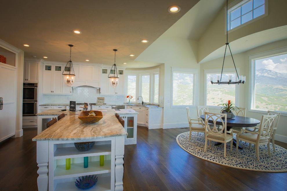 Large medium tone wood floor open concept kitchen photo in Salt Lake City with an undermount sink, shaker cabinets, white cabinets, white backsplash, subway tile backsplash, paneled appliances and an island