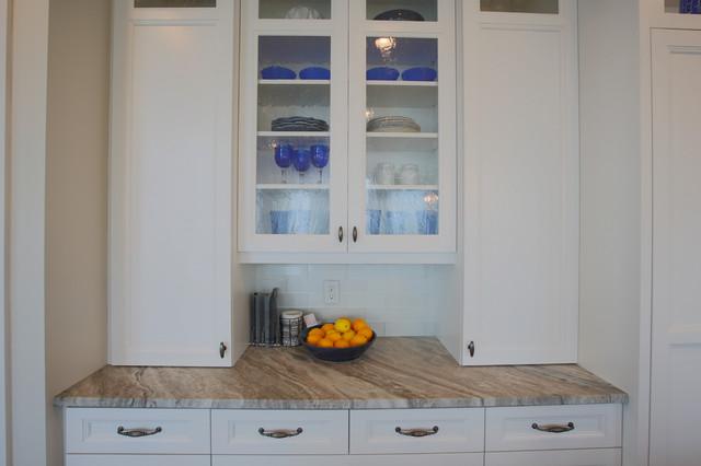 Open concept kitchen - large transitional medium tone wood floor open concept kitchen idea in Salt Lake City with an undermount sink, shaker cabinets, white cabinets, white backsplash, subway tile backsplash, paneled appliances and an island