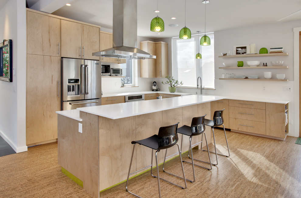 Example of a trendy l-shaped light wood floor kitchen design in Seattle with flat-panel cabinets, light wood cabinets, stainless steel appliances and an island