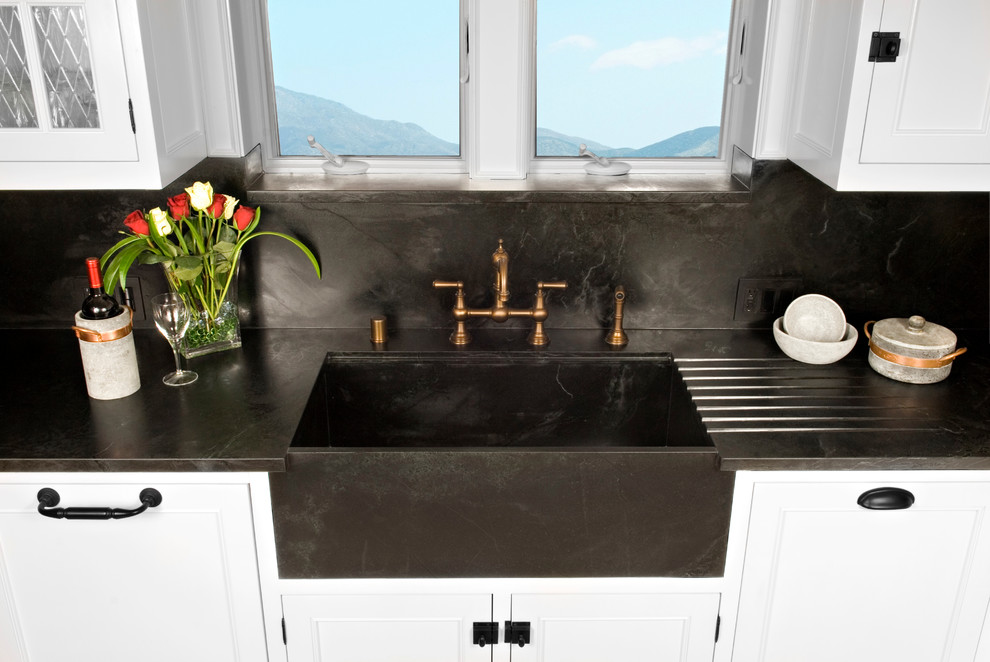 Elegant kitchen photo in San Diego with an integrated sink and soapstone countertops