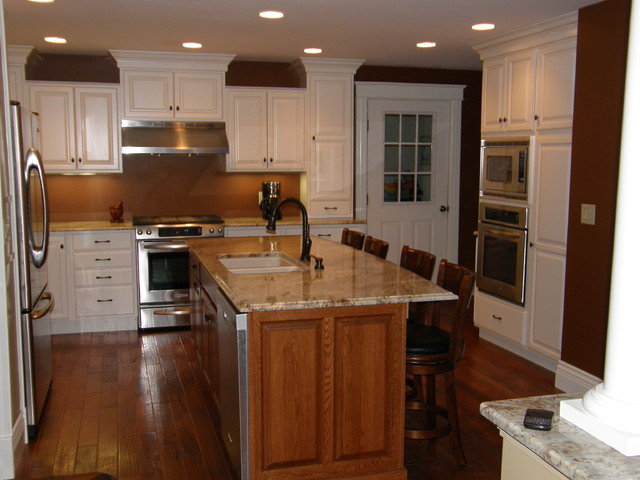 soft cream cabinetry with oak island traditional kitchen new york by bens appliance. Black Bedroom Furniture Sets. Home Design Ideas