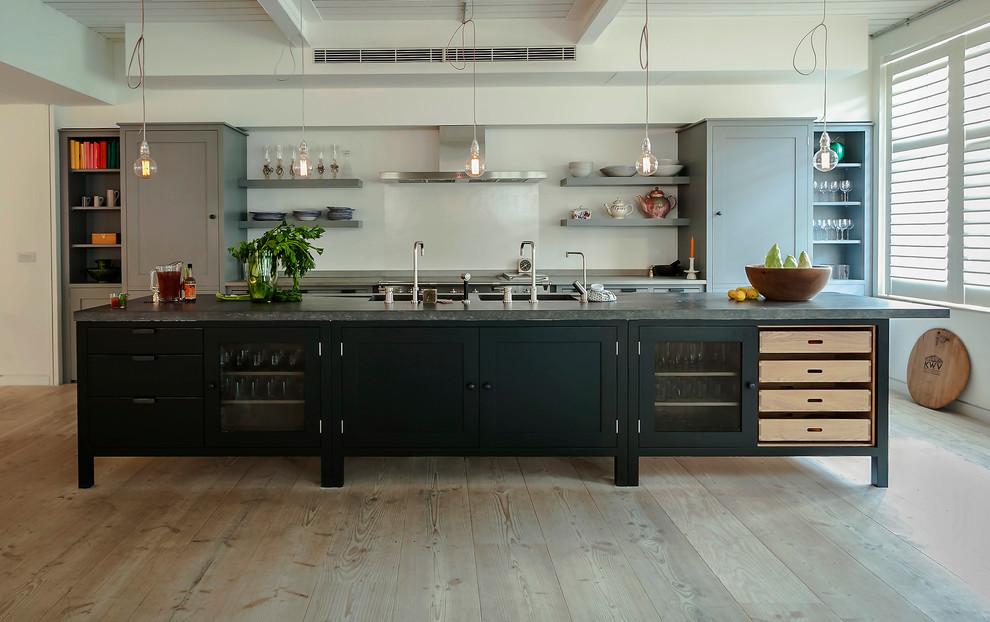 Kitchen - industrial kitchen idea in London