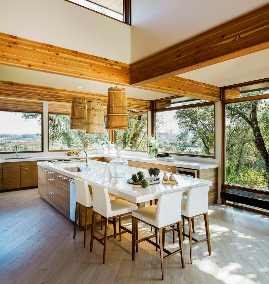 Inspiration for a contemporary light wood floor open concept kitchen remodel in San Francisco with an undermount sink, flat-panel cabinets, medium tone wood cabinets and an island