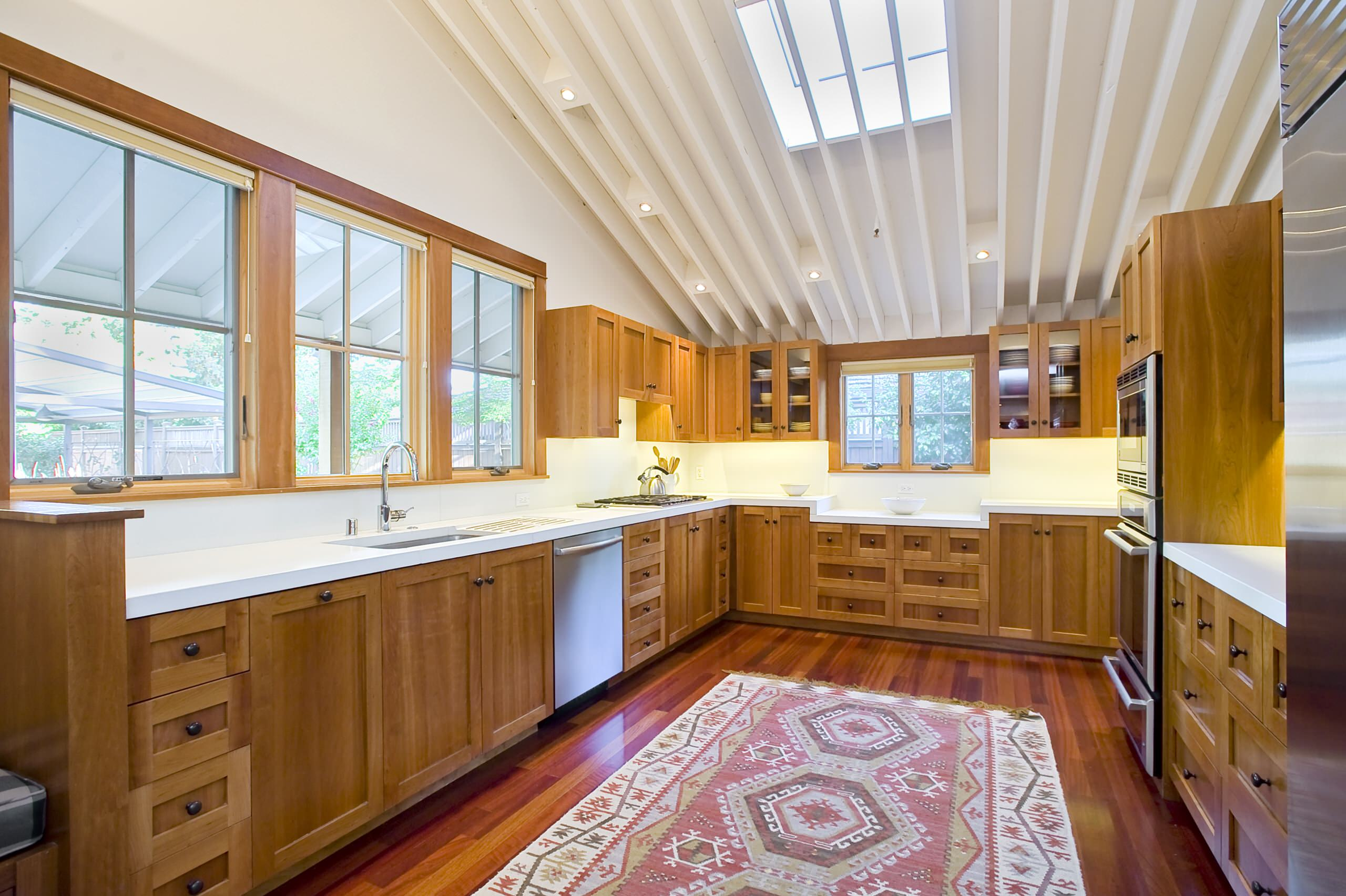 White Countertop Wood Cabinets Houzz
