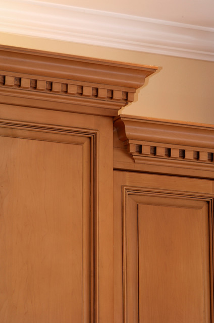 Sophisticated crown moulding with dentil in kitchen traditional