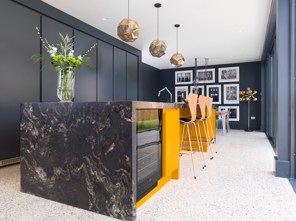 Example of a mid-sized trendy terrazzo floor and multicolored floor eat-in kitchen design in Other with flat-panel cabinets, black cabinets and an island