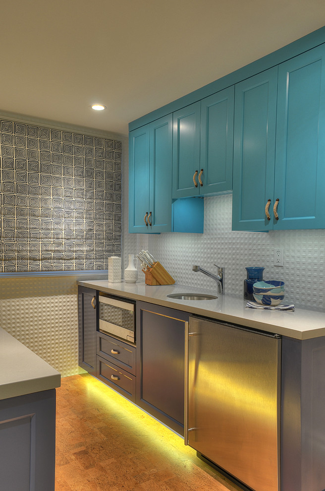 Trendy kitchen photo in Los Angeles with recessed-panel cabinets and blue cabinets