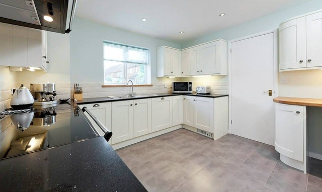 This is an example of a contemporary kitchen in Essex.
