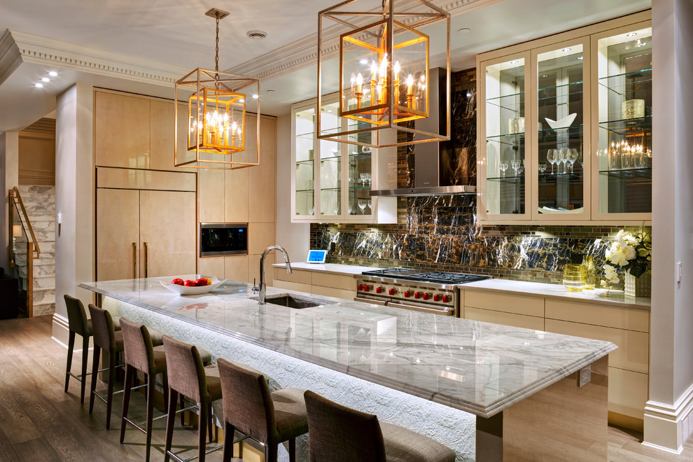Mid-sized transitional l-shaped medium tone wood floor eat-in kitchen photo in Vancouver with an undermount sink, flat-panel cabinets, light wood cabinets, marble countertops, brown backsplash, stone slab backsplash, paneled appliances and an island