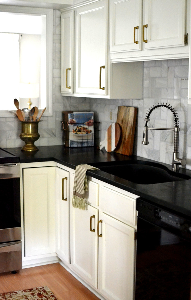 Inspiration for a mid-sized eclectic u-shaped enclosed kitchen remodel in Houston with raised-panel cabinets, white cabinets, soapstone countertops, white backsplash, marble backsplash, stainless steel appliances and an island