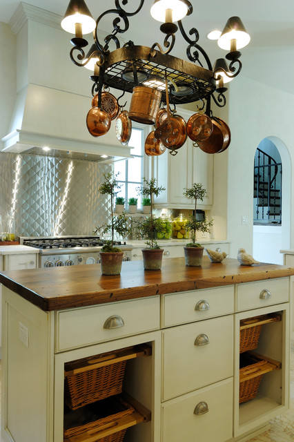 Tuscan kitchen photo in Tampa with wood countertops, metallic backsplash and an island