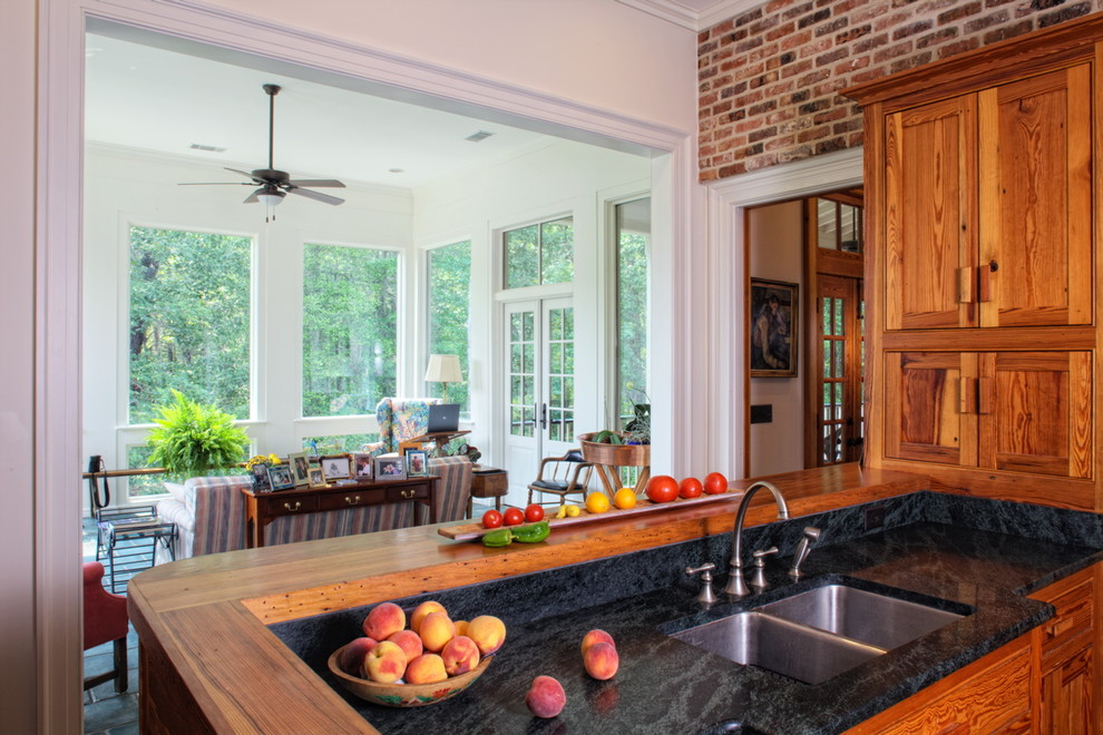 Example of a country kitchen design in Other with recessed-panel cabinets and medium tone wood cabinets
