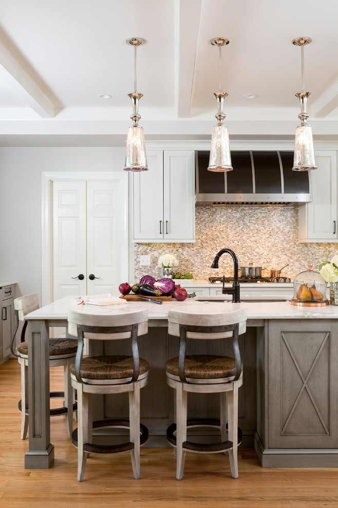 Example of a large mountain style l-shaped light wood floor enclosed kitchen design in DC Metro with an undermount sink, shaker cabinets, white cabinets, quartz countertops, multicolored backsplash, mosaic tile backsplash, stainless steel appliances and an island