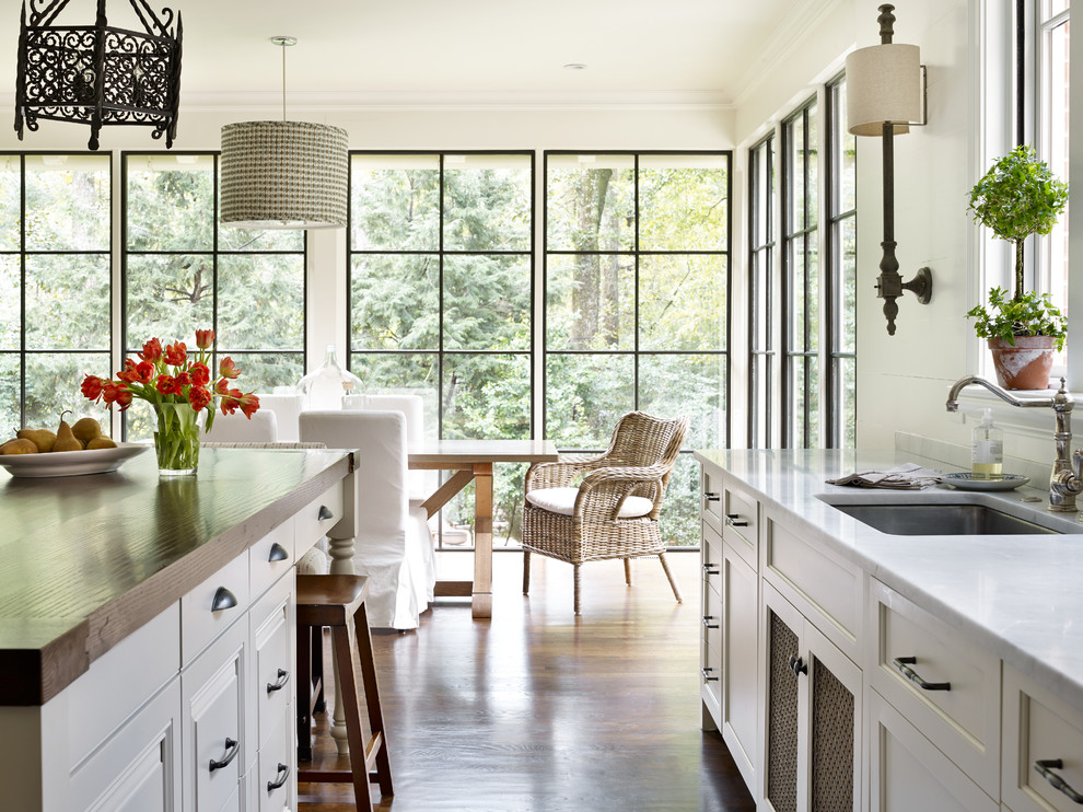 Inspiration for a timeless medium tone wood floor eat-in kitchen remodel in Atlanta with an undermount sink, recessed-panel cabinets, white cabinets and an island