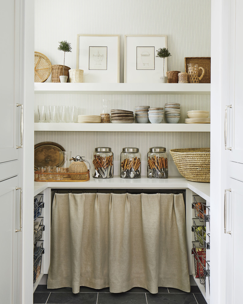 Inspiration for a coastal u-shaped black floor kitchen pantry remodel in Jacksonville with white countertops