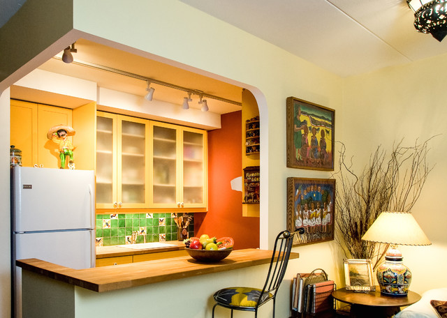 Example of a small southwest galley eat-in kitchen design in San Francisco with a drop-in sink, glass-front cabinets, light wood cabinets, wood countertops, green backsplash, mosaic tile backsplash, white appliances and a peninsula