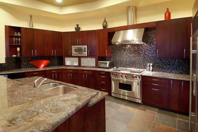 cherry wood kitchen cabinets. kitchen in luxury home with cherry