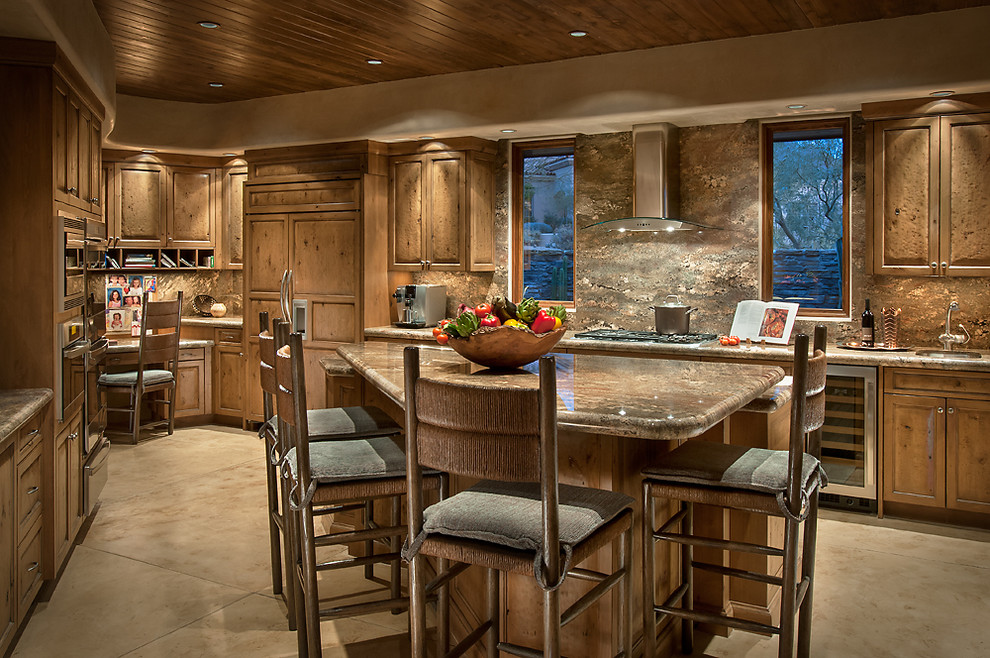 Large southwest u-shaped concrete floor enclosed kitchen photo in Phoenix with raised-panel cabinets, light wood cabinets, granite countertops, stone slab backsplash, stainless steel appliances, an island and an undermount sink