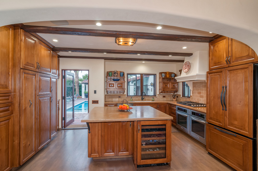 Example of a tuscan kitchen design in Denver