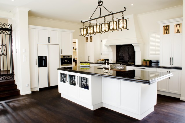 mediterranean kitchen by Mal Corboy Design and Cabinets