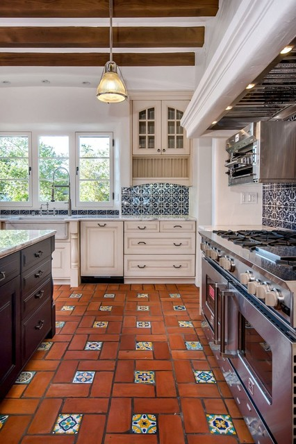 tuscan terra cotta floor kitchen photo in san francisco with a farmhouse sink white - Spanish Style Kitchen