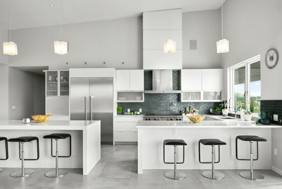 Kitchen - contemporary u-shaped porcelain tile, gray floor and vaulted ceiling kitchen idea in Other with an undermount sink, flat-panel cabinets, white cabinets, quartzite countertops, blue backsplash, subway tile backsplash, stainless steel appliances, two islands and white countertops
