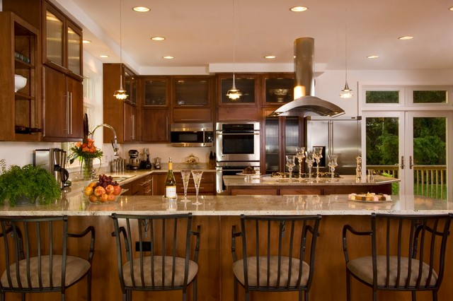 Eat-in kitchen - rustic u-shaped eat-in kitchen idea in Other with shaker cabinets, dark wood cabinets, granite countertops, stainless steel appliances and an island