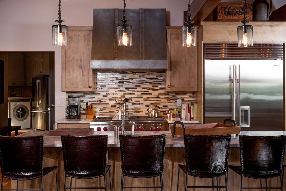 Inspiration for a mid-sized rustic single-wall eat-in kitchen remodel in Other with shaker cabinets, medium tone wood cabinets, granite countertops, beige backsplash, matchstick tile backsplash, stainless steel appliances and an island