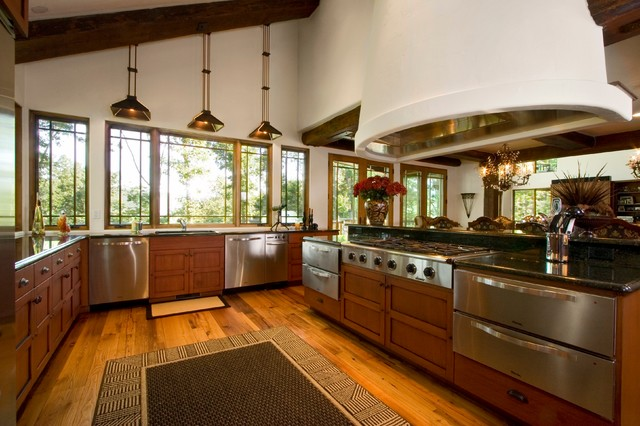 Large mountain style u-shaped medium tone wood floor eat-in kitchen photo in Other with a double-bowl sink, recessed-panel cabinets, medium tone wood cabinets, granite countertops, stainless steel appliances and an island