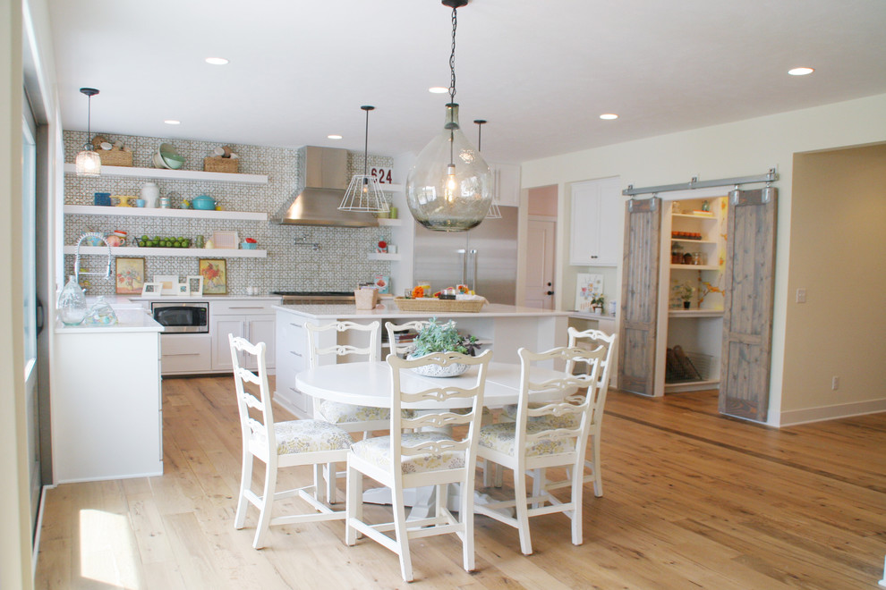 Inspiration for a timeless eat-in kitchen remodel in Grand Rapids with open cabinets, white cabinets, green backsplash and stainless steel appliances