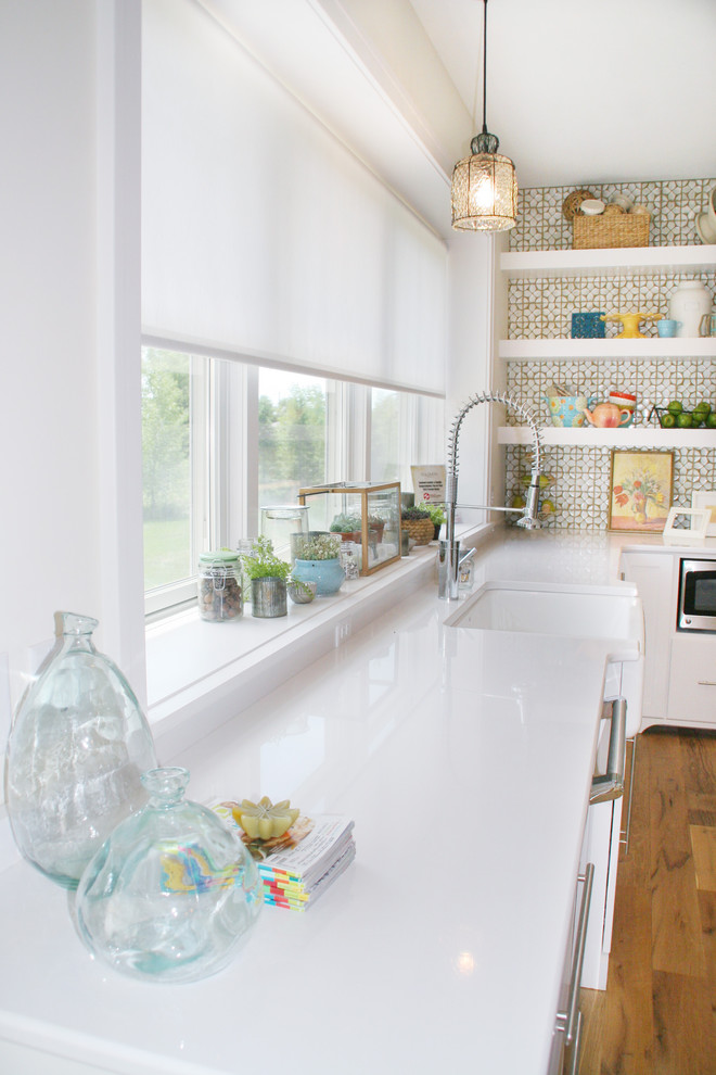 Eclectic kitchen photo in Grand Rapids with a farmhouse sink and white cabinets