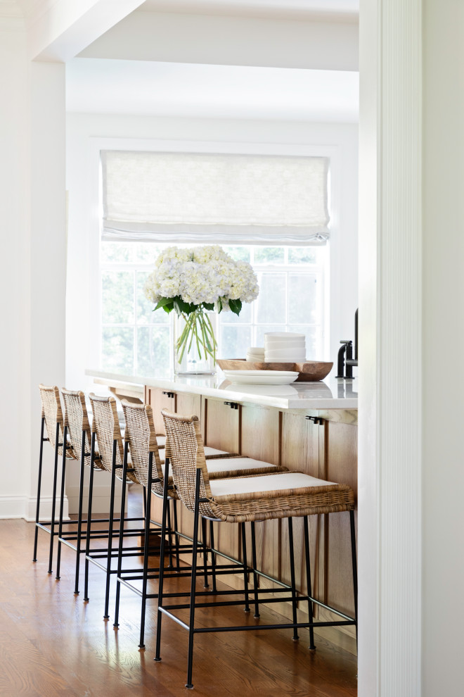 Inspiration for a large transitional galley medium tone wood floor and brown floor open concept kitchen remodel in Orlando with a farmhouse sink, shaker cabinets and an island