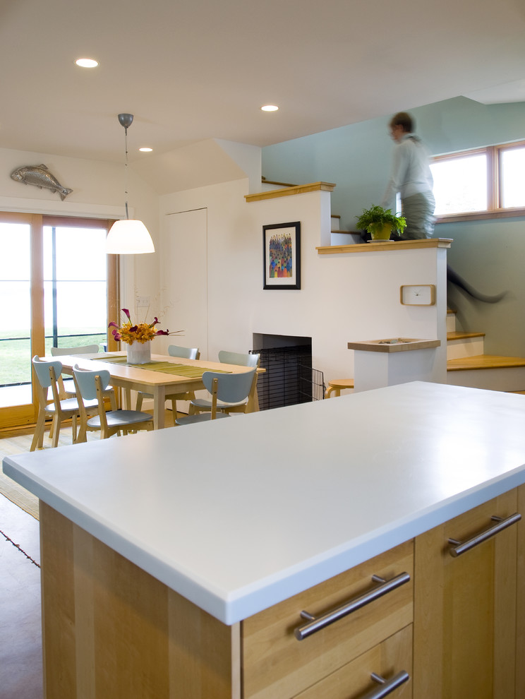 Inspiration for a contemporary eat-in kitchen remodel in San Francisco with flat-panel cabinets and light wood cabinets