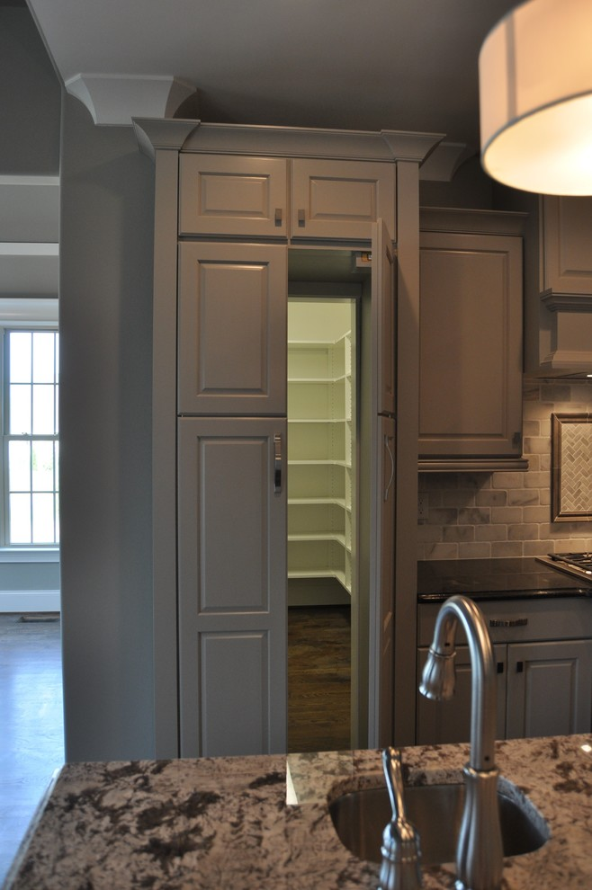 Example of a transitional kitchen design in Raleigh