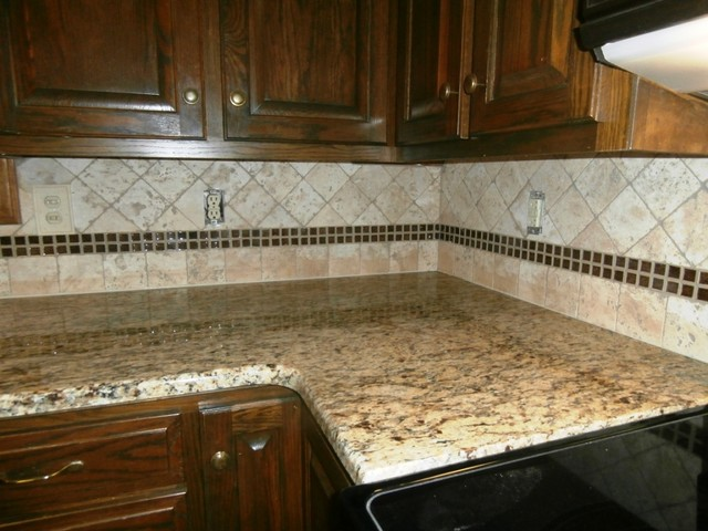 St Cecilia Granite On Dark Cabinets Traditional