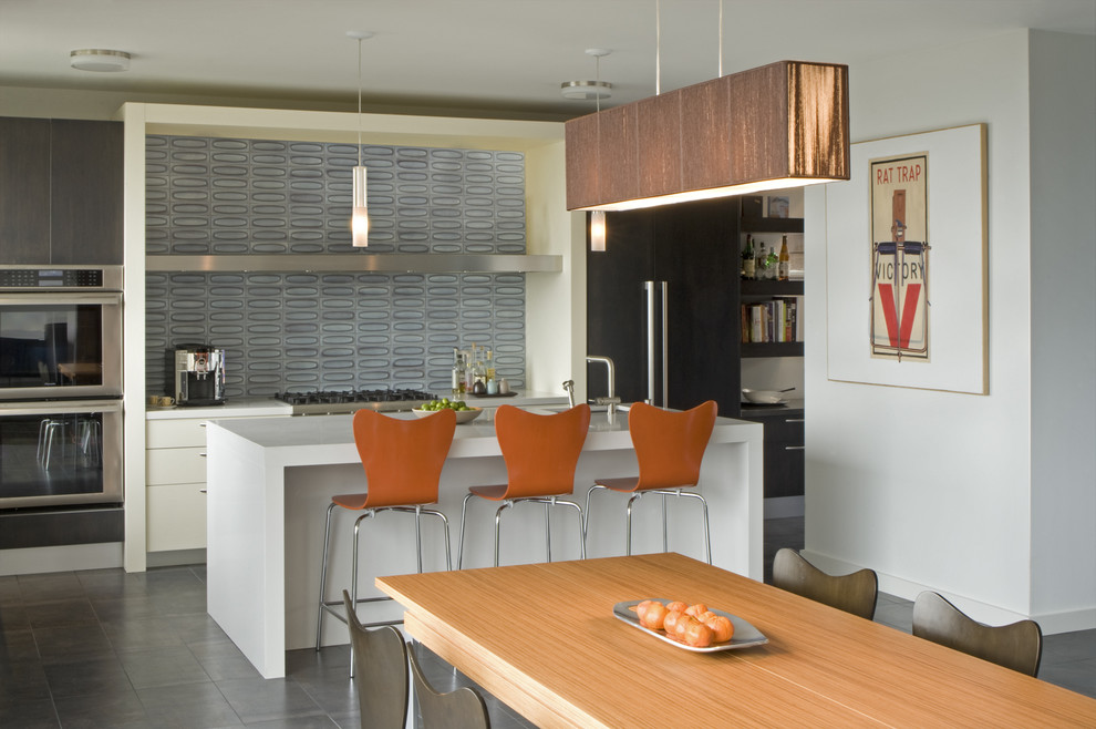 Eat-in kitchen - modern eat-in kitchen idea in San Francisco with stainless steel appliances, quartz countertops, blue backsplash, glass tile backsplash, flat-panel cabinets and white cabinets