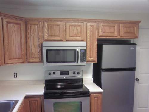 what is the suggested height of a microwave over the stove. Black Bedroom Furniture Sets. Home Design Ideas